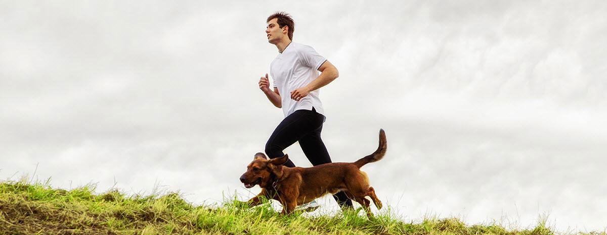 man-running-with-dog-istock